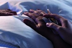 Panorama of person assisting elderly dying hospice patient